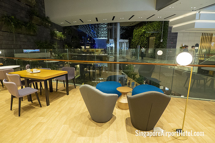 KOMYUNITI dining lounge overlooks the famous Rain Vortex at Jewel Changi Airport