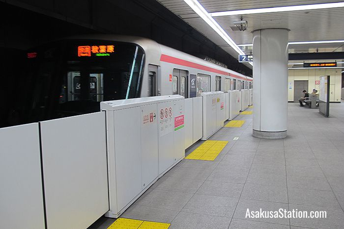 A train departing at Platform 2 TX Asakusa Station