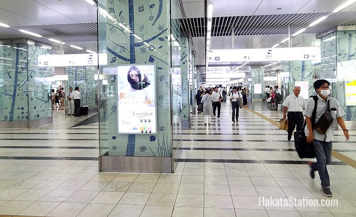 A broad tiled corridor runs through the main part of Hakata Station