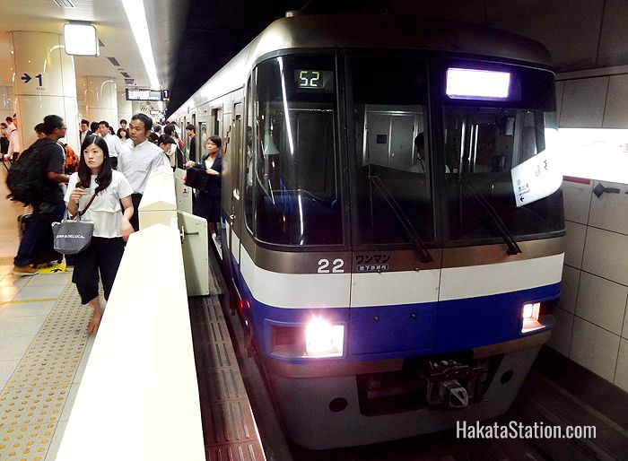 A subway bound for Fukuoka Airport waits to depart from Hakata Station