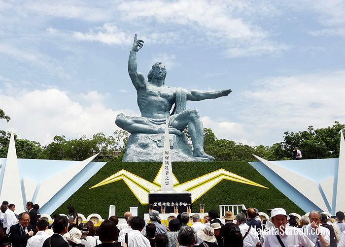 The 10-meter-tall Peace Statue by Seibo Kitamura dominates Nagasaki's Peace Park, seen here during a memorial ceremony