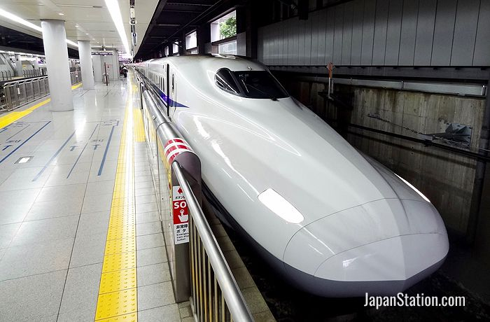Bound for Shin-Osaka Station, this Hikari service on the Tokaido Shinkansen bullet train will stop at Odawara Station