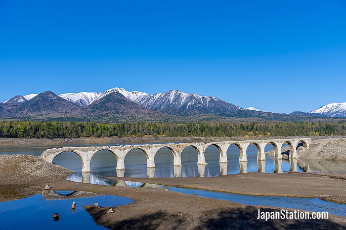 Lake Nukabira's Taushubetsu Bridge, built in 1937, is known as the phantom bridge because it becomes submerged around June every year