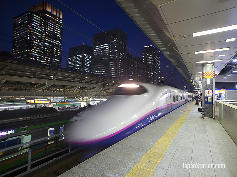 An E2 series Shinkansen train departing from Tokyo Station