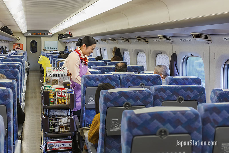 Ordering refreshments in a comfortable seat on a Shinkansen train