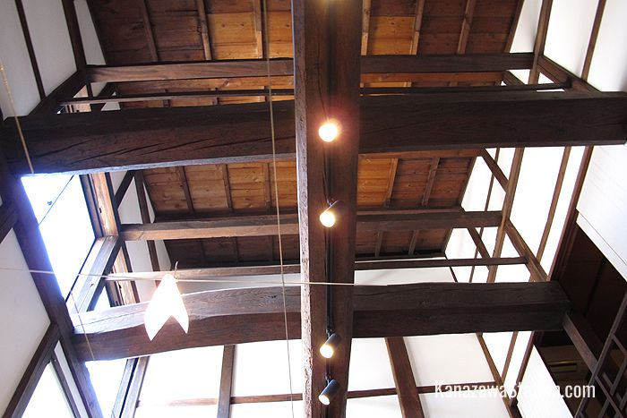 Inside Muku broad wooden beams support the high ceiling