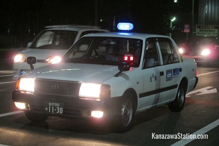 An available Kintetsu taxi at night