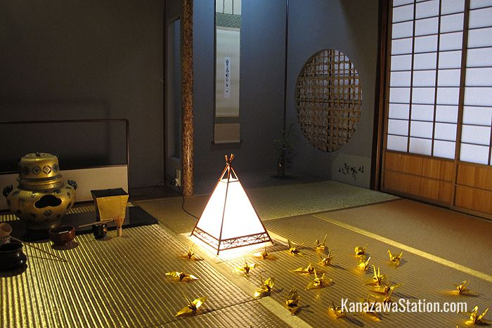 Origami cranes of folded gold leaf decorate the floor of the Golden Tea Room