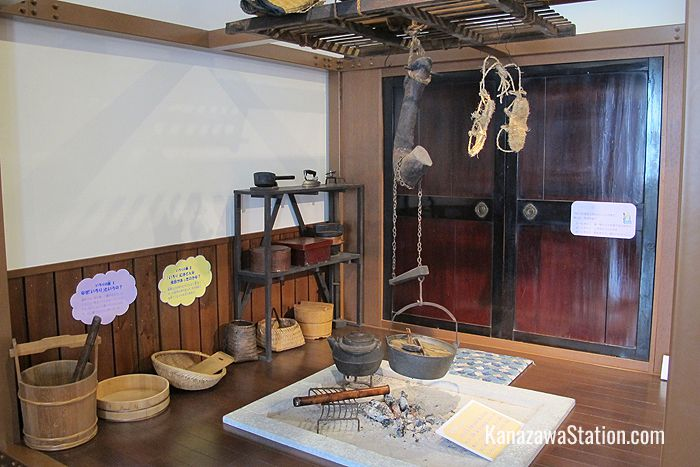 A reconstructed farmhouse hearth with objects children can pick up and handle