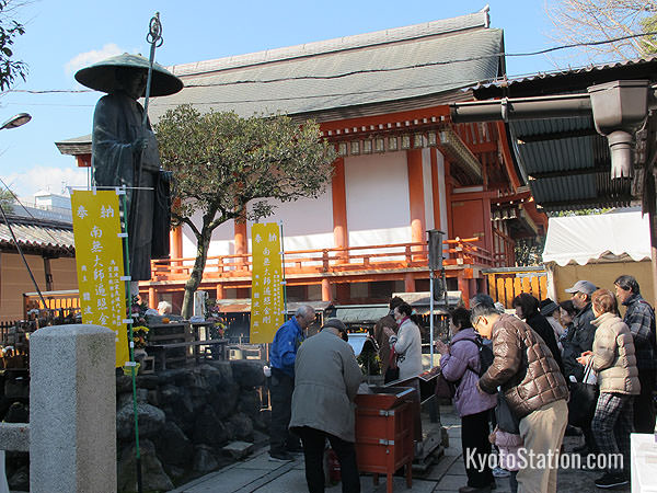 Temple goers pay their respects at the statue of Kukai