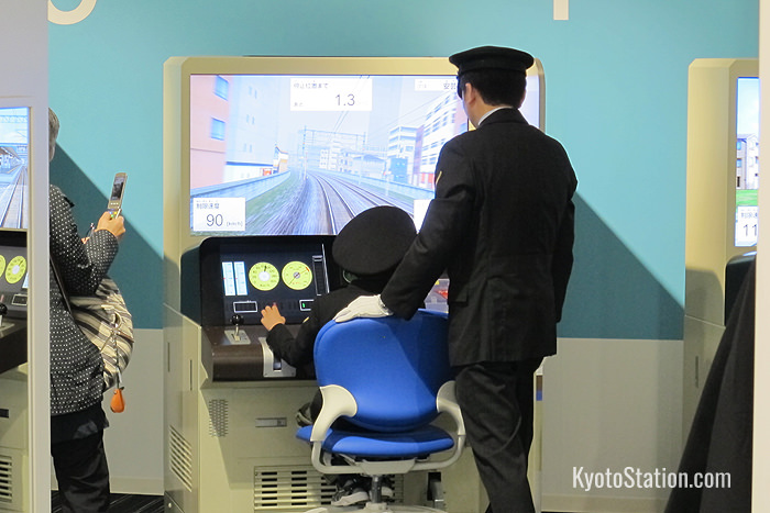 Visitors who practice using the train driving simulator also get to wear a train driver's cap!