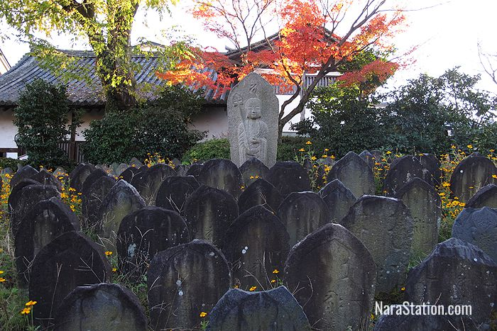 In the grounds you will find many Buddhist figures, grave markers, and stone lanterns