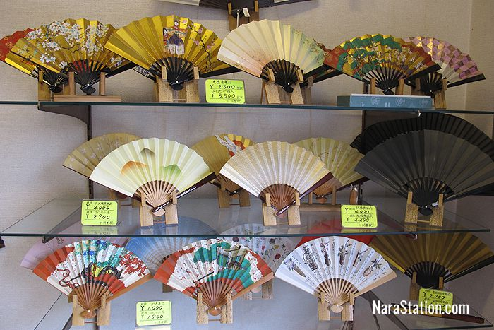 A colorful display of folding fans at Ikeda Gankodo