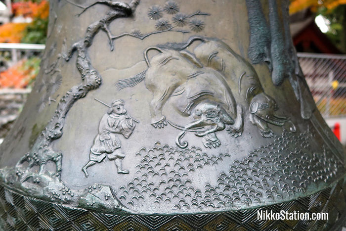 A detail of the elephants on one of the bronze lanterns