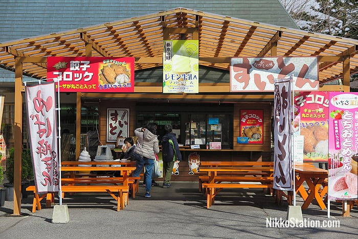 A shop selling gyoza croquettes, lemon ice cream, and suiton dumplings in soup