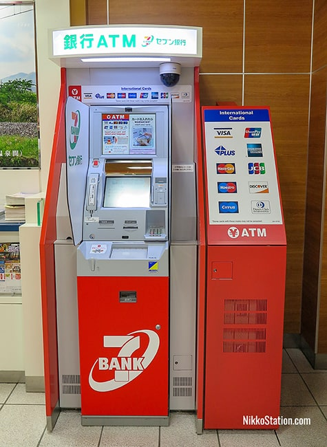 The 7-Bank ATM is beside the ticket gates