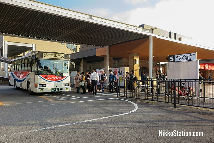 Passengers boarding the bus for Kinugawa Onsen's hotels at Bus Stop 5
