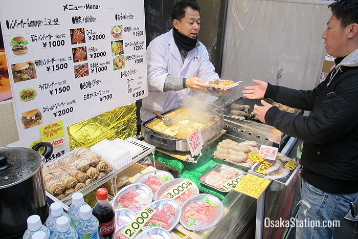 This store sells burgers, sausages, yakiniku beef kebabs and other meaty snacks