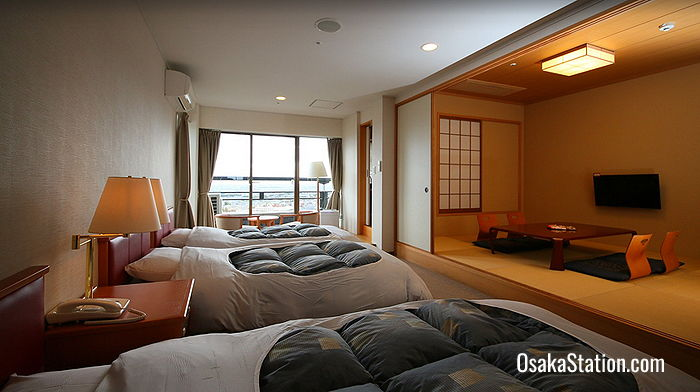 A room with triple beds and a Japanese style living area
