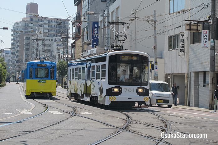 Two trams passing near Sumiyoshi Station
