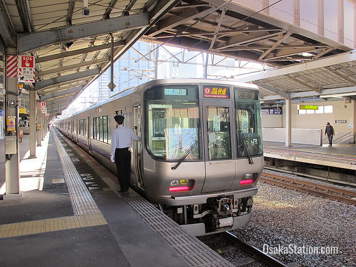 An Osaka Loop Line Train bound for Tennoji at Kyobashi Station