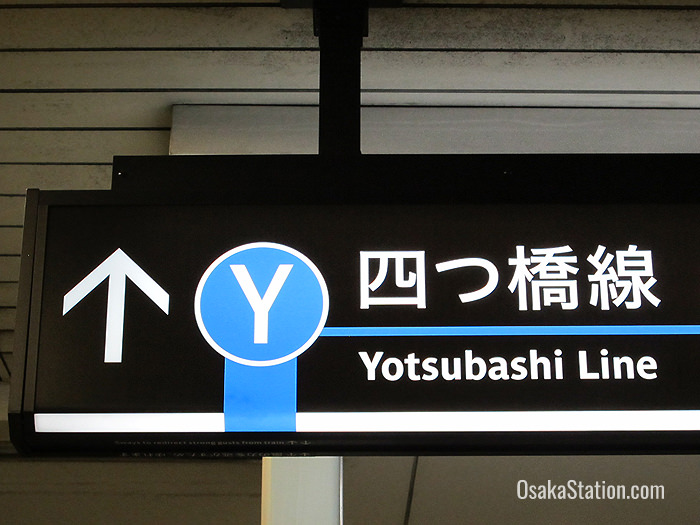 Signs for the Yotsubashi Line are color-coded blue
