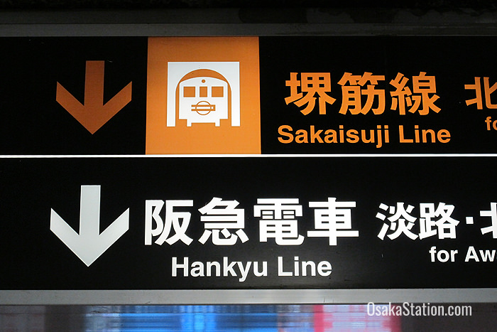 Signs for the Sakaisuji line are color-coded brown