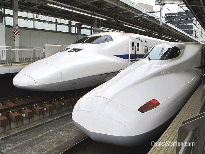 Two shinkansen bullet trains at Shin-Osaka Station