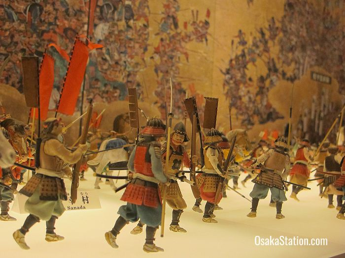A miniature reproduction of a screen painting in the castle museum depicts the 1615 Summer War in Osaka