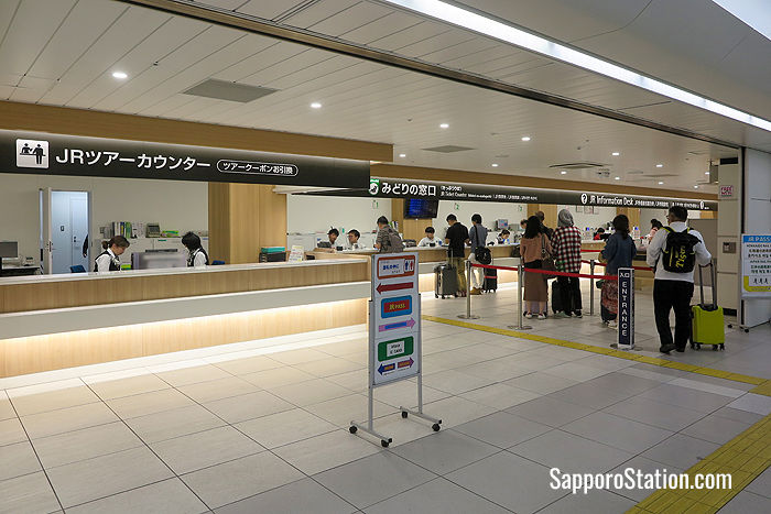 A tour counter, ticket office and information counter at New Chitose Airport Station