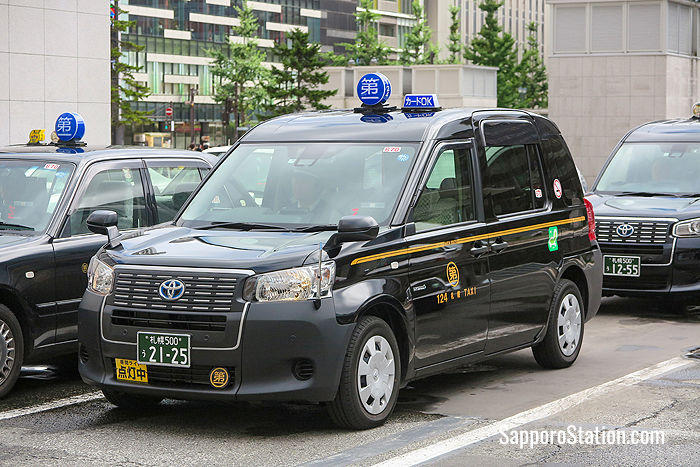 A Daichi taxi. The blue logo contains the name Daichi written in the characters 第一