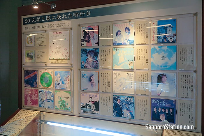 A display inside the Clock Tower museum showing works of literature and song that have celebrated Sapporo Clock Tower