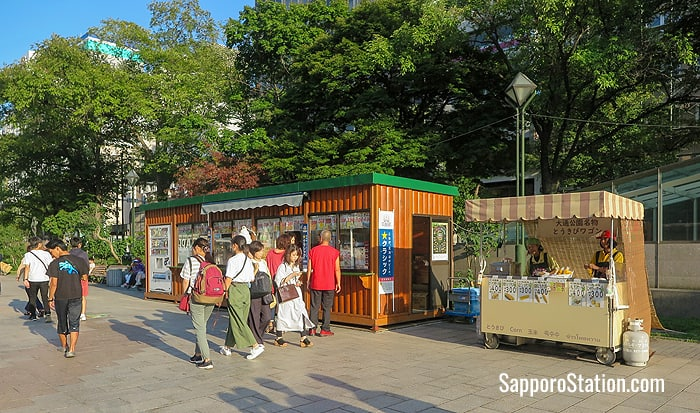 A summer sweetcorn stall set up beside a more permanent takeaway food and refreshment store