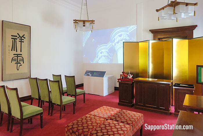 Videos are projected on the walls of the Tsubaki ceremonial room