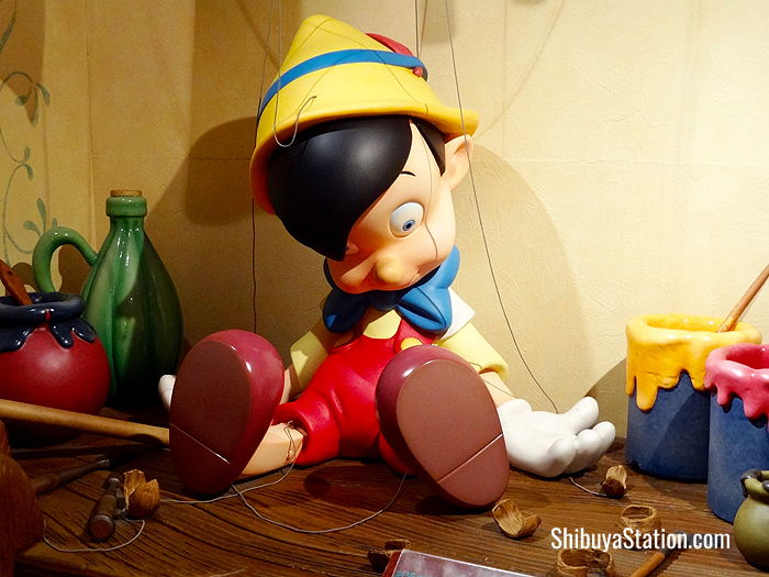 Pinocchio features in a mockup of Geppetto's workshop at the Disney Store