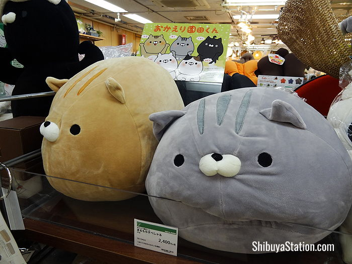 Furry feline cushions at Tokyu Hands