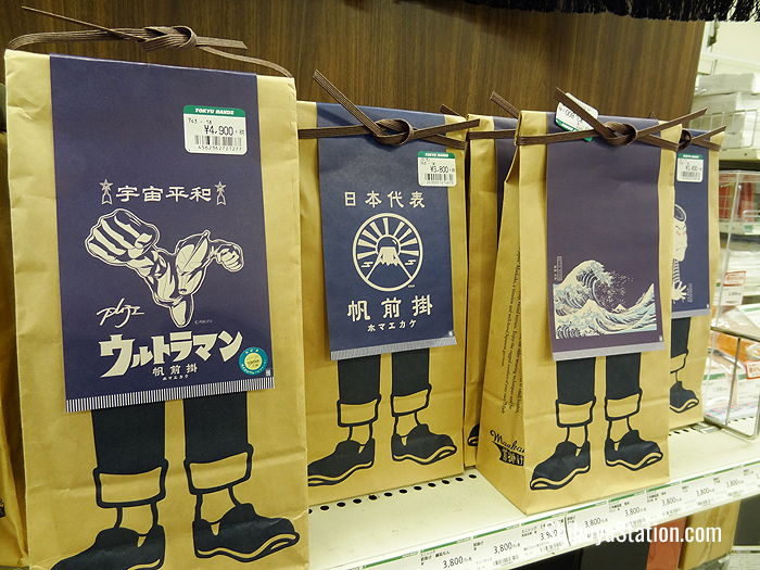 Old school Japanese denim aprons featuring Ultraman and Edo Period motifs