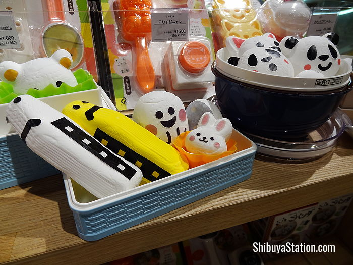 Mock-ups of rice balls in the shape of Shinkansen bullet trains, bunnies and pandas are used to display rice ball molds at Loft Shibuya