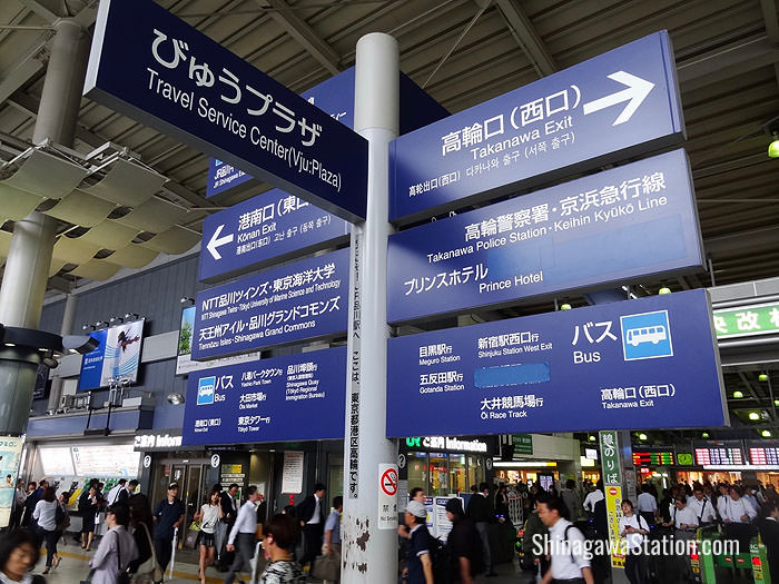 A signboard by the Central Gate at JR Shinagawa Station points the way