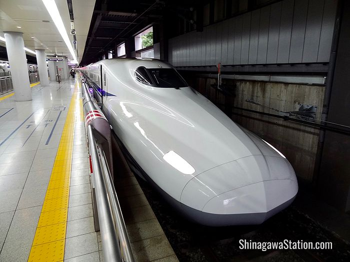 A bullet train bound for Kyoto and Osaka waits at Shinagawa Station