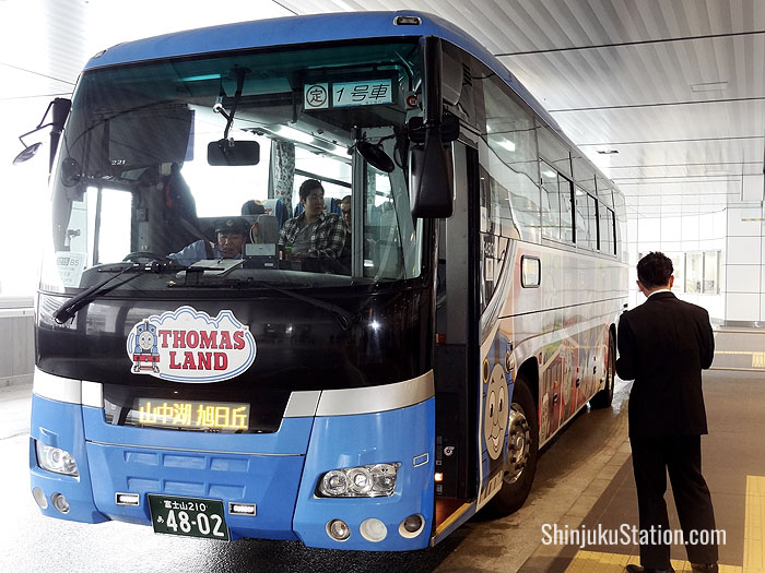 A bus bound for Lake Yamanaka near Mt. Fuji boards passengers at Basuta Shinjuku