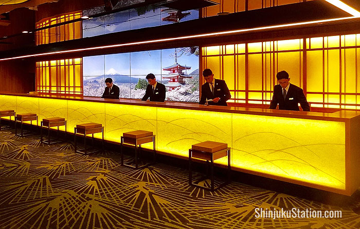 The renovated lobby features a sleek front desk with LCD screens showing eye-popping views of Japan