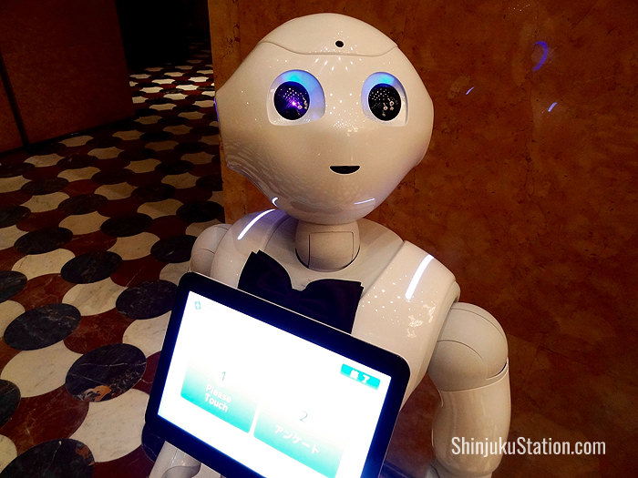 SoftBank's humanoid robot Pepper stands near the front desk