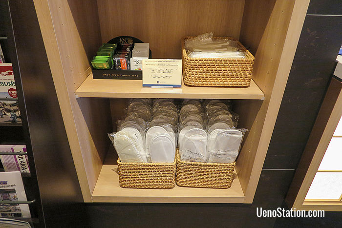 Free tea, coffee, extra slippers and other amenities are available in the lobby