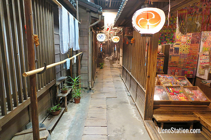 A recreated tenement alleyway with a dagashiya sweet shop on the right