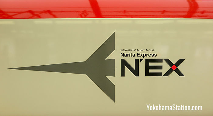 The NE'X logo on the body of the train