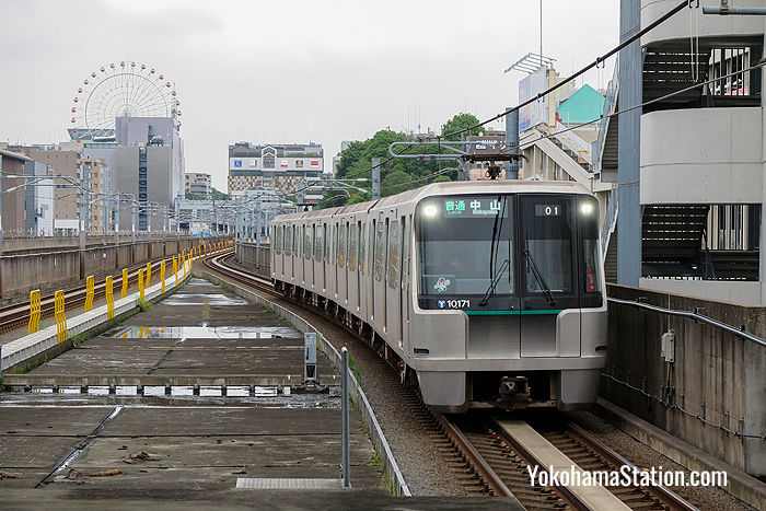 A Green Line train arriving at Center-Minami Station. Some parts of the line are above ground