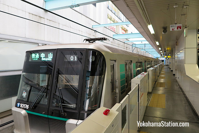 A Green Line train at Center-Minami Station. Platform screen doors are installed on all platforms to ensure passenger safety