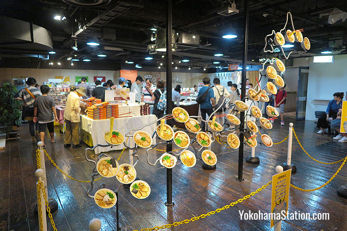 The 1st floor features a map of Japan made from ramen bowls